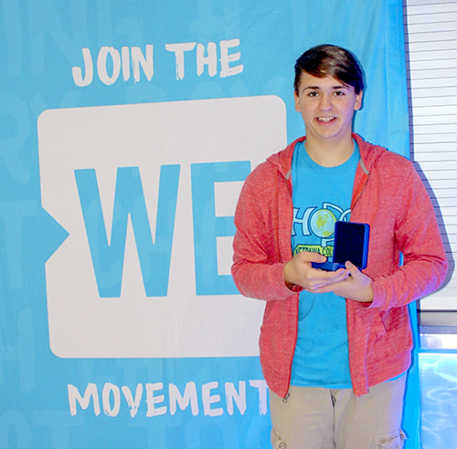 Online-Declan with award and sign